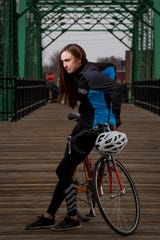 Andrea Parrott poses for a portrait on the Jackson street bridge on Tuesday, March 24, 2020, in Des Moines. Parrott is returning to RAGBRAI after leaving the ride last fall.