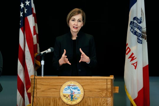 Iowa Gov. Kim Reynolds updates the state's response to the coronavirus during a news conference at the State Emergency Operations Center, Tuesday, March 24, 2020, in Johnston, Iowa. (AP Photo/Charlie Neibergall, Pool)