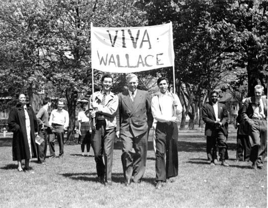 Progressive Party presidential candidate Henry A. Wallace poses for a photo with Latino youth  during a campaign visit to William Penn College in Oskaloosa, Ia., in 1948.
