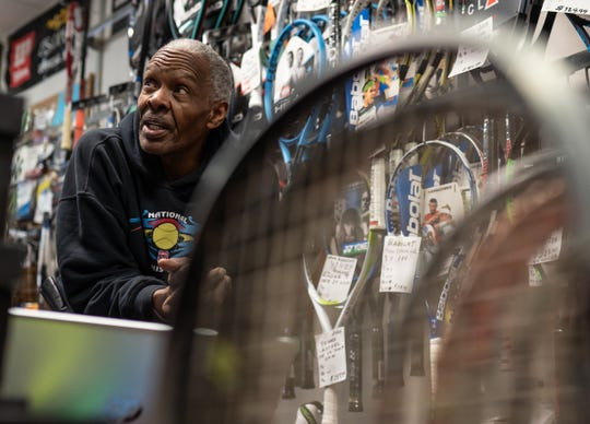 Professional Racquet Services owner Michael Banks talks on March 23, 2020, about temporarily closing his business in Detroit as part of Gov. Gretchen Whitmer's executive order to help combat the spread of COVID-19.