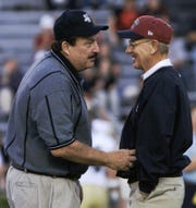 Vanderbilt coach Woody Widenhofer, left, and University of South Carolina coach Lou Holtz chat in midfield prior to  their game Saturday night Oct. 20, 2001, at Williams-Brice Stadium in Columbia, S.C. South Carolina defeated Vanderbilt, 46-14.