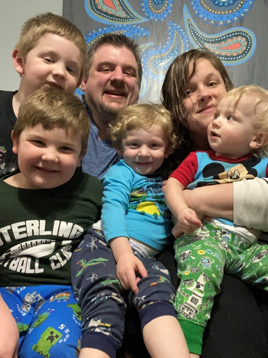 Jon Miron, 39, lost his job Friday at Art Van Furniture, which filed for bankruptcy in early March. Employees thought they had until May 5 to work but the retailer said it closed its stores early due to the coronavirus crisis. Pictured clockwise, Jon Miron, his wife Jennifer, and sons, Eli, age 1; Kaiser, 2; August, 4 and Dexter, 6.