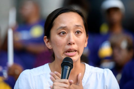 FILE - Michigan State Representative Stephanie Chang sheds a tear while speaking in support of the members of SEIU Local 1 Janitors a strike authorization announcement in front of One Campus Martius, in Detroit, July 23, 2018.