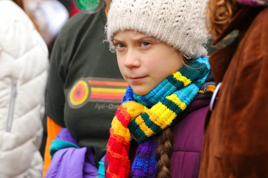 Swedish climate activist Greta Thunberg marches with others during a climate change protest in Brussels in this March 6, 2020, file photo. Thunberg says she has recovered after being infected with the coronavirus on a trip to central Europe.