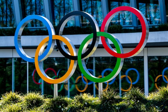 The Olympic Rings are displayed at the entrance of the IOC, International Olympic Committee headquarters in Lausanne, Switzerland, Tuesday.