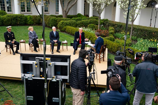 President Donald Trump talks with host Bill Hemmer during a Fox News virtual town hall with members of the coronavirus task force, in the Rose Garden at the White House, Tuesday, March 24, 2020.