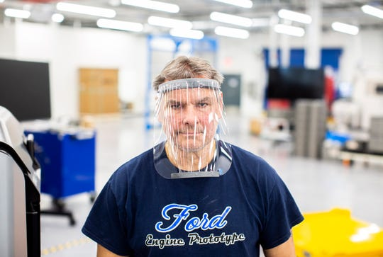 Dave Jacek, 3D printing technician, wears a prototype of a 3D-printed medical face shield printed at Ford's Advanced Manufacturing Center in Redford. Ford Motor Co., joining forces with firms including 3M and GE Healthcare, is expanding production of medical equipment and supplies for healthcare workers, first responders and patients fighting coronavirus.