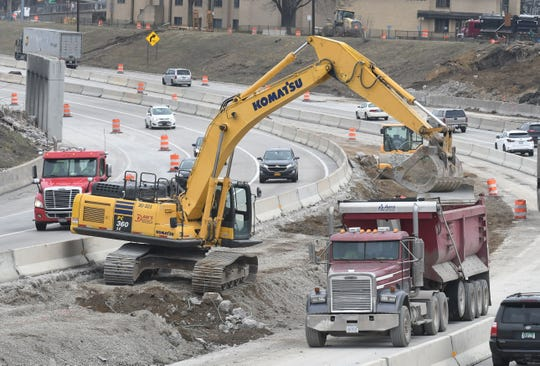Construction workers continue working on I-75 at 9 mile in Ferndale on March 24.