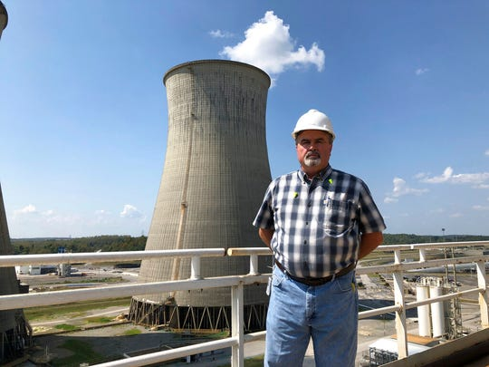 Steve Holland, general manager of the Paradise Fossil Plant, stands near one of the plant's cooling towers in Drakesboro, Ky., on Sept. 12, 2019. Holland oversaw the Tennessee Valley Authority plant as it burned its last load of coal and shut down in February.