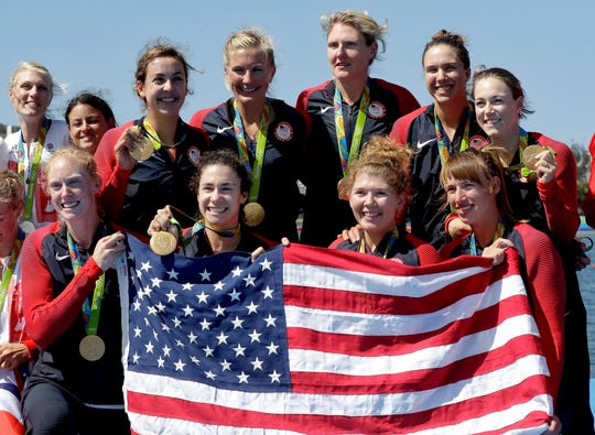 Michigan State's Emily Regan (lower left) helped the U.S. win gold in the women's rowing eight during the 2016 Summer Olympics in Rio de Janeiro.