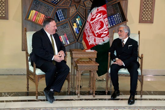 U.S. Secretary of State Mike Pompeo, left, meets with Abdullah Abdullah the main political rival of President Ashraf Ghani at the Sepidar palace, in Kabul, Afghanistan, Monday, March 23, 2020.