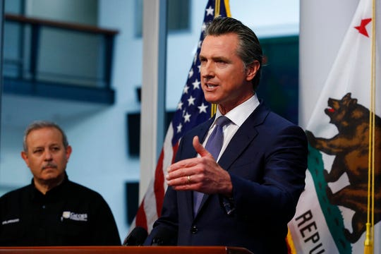 Gov. Gavin Newsom updates the state's response to the coronavirus at the Governor's Office of Emergency Services in Rancho Cordova, Calif., Monday, March 23, 2020.