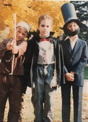 Matt, left, poses for a Halloween picture with brothers Brian, center, and Scott. Hey, only one culturally insensitive costume ... not bad.