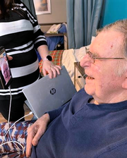 Mason Bennett, a resident at the Corning Center for Rehabilitation and Healthcare, enjoys a FaceTime conversation with his wife Bonnie.