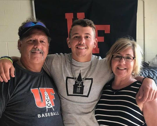 Clyde's Cam Farrar first learned his baseball season at the University of Findlay was canceled this year. His day changed when father, Brad Farrar, informed Farrar he was cancer free. They're joined by Farrar's mother, Kimberly.