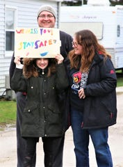 Students and parents greet a caravan of Otis Elementary teachers who drove drove through their school's neighborhood in Fremont on Tuesday.