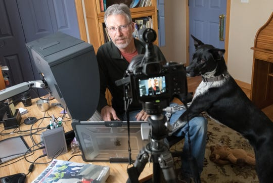 "Colorado State University photographer with University Communications and Department of Journalism and Media Communications adjunct faculty member Bill Cotton and his dog Kobe record a ""Welcome Back"" video to move from an in-person to an online-class, March 21, 2020."