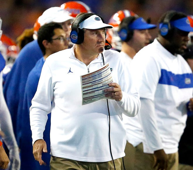 Florida Gators head coach Dan Mullen looks over to his team as he walks the sideline during the rivalry game against Florida State at Ben Hill Griffin Stadium in Gainesville, Fla., on Nov. 30, 2019.