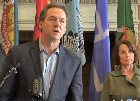 Gov, Steve Bullock talks Tuesday about the coronavirus outbreak in Montana, At right is Sheila Hogan, director of the Department of Public Health and Human Services.