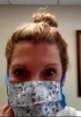 Margo Muniz, director of Obstetrics and Gynecology at Northern Montana Hospital, takes a selfie with a homemade mask.