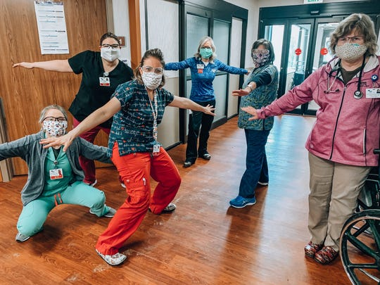 Northern Montana Hospital employees practice social distancing while posing with homemade masks.