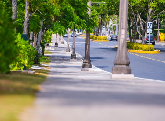 The near empty street of San Vitores Road and a sidewalk barren of commuting tourists in Tumon, may illustrate the impact of social distancing, in light of precautions exercised during the pandemic of the coronavirus, or COVID-19, on Tuesday, March 24, 2020.