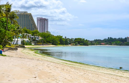 Hardly a person could be seen along the shoreline of Tumon Bay, south of Matapang Beach Park, on Tuesday, March 24, 2020.