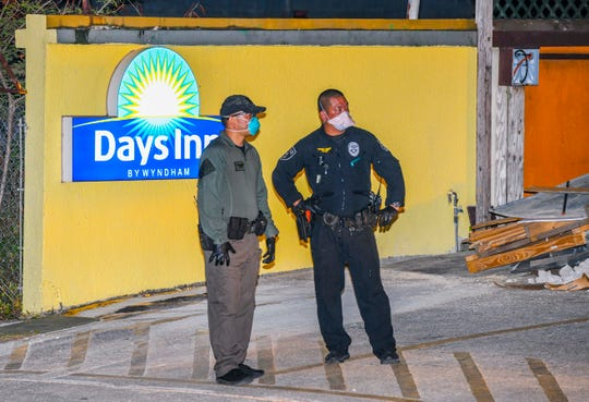 Law enforcement officers and other government employees at the Days Inn on Ypao Road in Tamuning in this March 23 file photo. Nathan Gagnon said little to nothing is being communicated to those in quarantine.