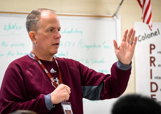 Henderson County baseball coach Adam Hines talks to students during a discussion on digestion in health class at the high school Wednesday, February 26, 2020.