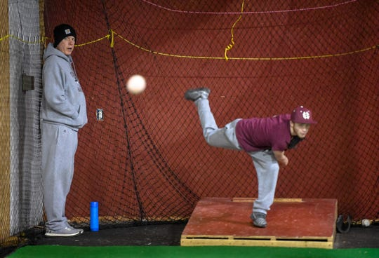 Henderson County baseball coach Adam Hines watches  pitcher Brenden Haire during a preseason baseball practice Wednesday, February 26, 2020.