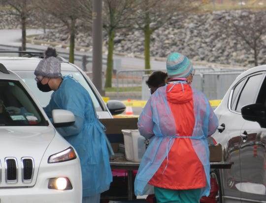 Cayuga Medical Center personnel collected samples for coronavirus testing at a sampling center location set up in the parking lot of The Shops at Ithaca Mall.