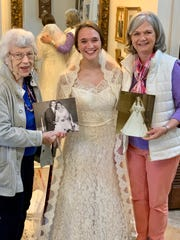 Three generations who share the same wedding gown are from left, Mary Cobb, Mary Grace Jimenez and Susan Cobb. Mary Grace Jimenez of Jackson will be the next bride to wear the gown.