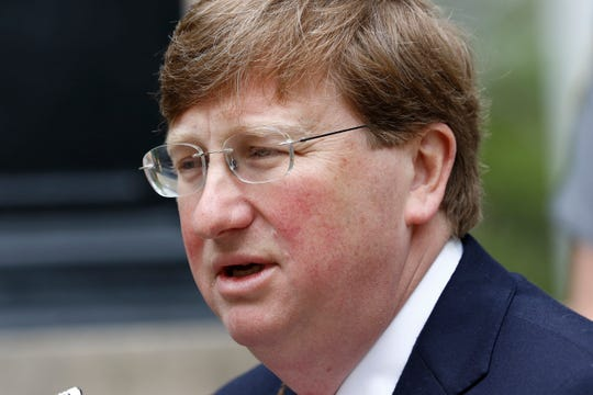 Mississippi Republican Gov. Tate Reeves speaks with reporters outside the Governor's Mansion to give an update on the current situation of COVID-19 in the state and discuss Mississippi's ongoing response to slow the spread, Tuesday, March 24, 2020 in Jackson, Miss.