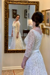 Mary Grace Jimenez of Jackson smiles at seeing herself in her grandmother's vintage wedding gown.