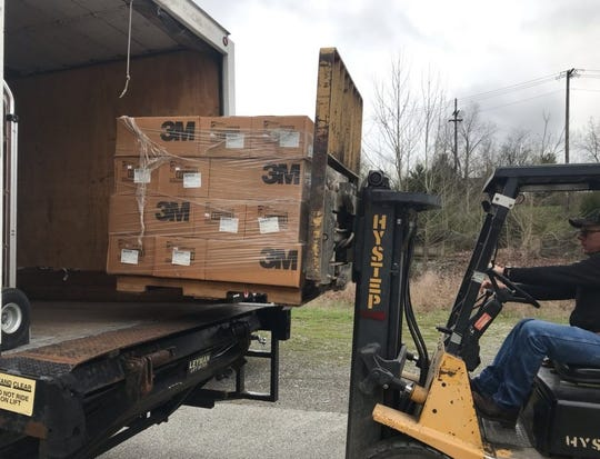 Respiratory masks donated by the Tennessee Valley Authority in response to the coronavirus pandemic are loaded onto a truck March 23, 2020.