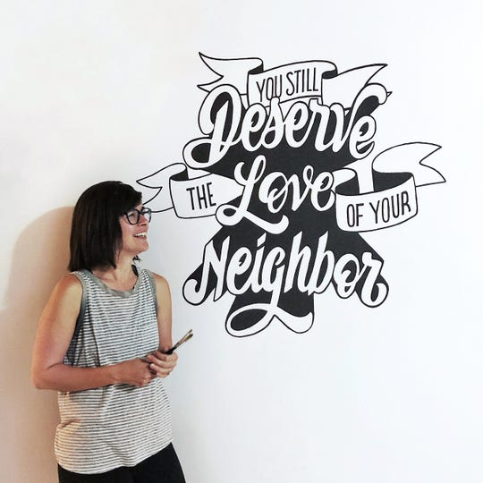 """""""I called up my best friend and asked if I could do this,"""" said Amanda Smith, pictured here. """"She came up with the quote from a Drew Holcomb and the Neighbors song and graciously agreed to lend me the wall in her kitchen so I could start practicing large scale lettering."""" Sept. 19, 2019."""