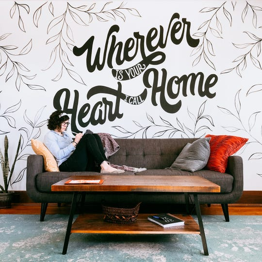 This large mural is in artist Amanda Smith's new North Knoxville living room. Smith offers custom hand lettering through her brand, The Paper Heron.