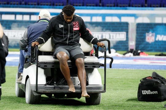 Feb 29, 2020; Indianapolis, Indiana, USA; Louisiana State Tigers linebacker Patrick Queen (LB32) looks dejected as he leaves on a golf cart after suffering an injury during the 2020 NFL Combine at Lucas Oil Stadium. Mandatory Credit: Brian Spurlock-USA TODAY Sports