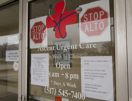 A sign on the door of Ascent Urgent Care in Genoa Township, shown Tuesday, March 24, 2020, instructs patients showing signs of COVID-19 to not enter the building but instead to call their primary care provider.