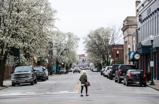 Spring Street in Jeffersonville had blooming Bradford Pear trees but most of the downtown shops were closed except for a few eateries such as Ramiro's Cantina Express and Red Yeti. March 24, 2020