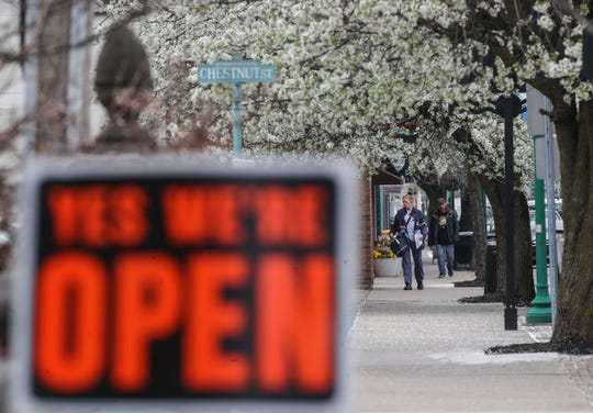 Spring Street in Jeffersonville had blooming Bradford Pear trees but most of the downtown shops were closed except for a few stores such as Ramiro's Cantina Express, which had a sidewalk sign letting the public know they were open. March 24, 2020