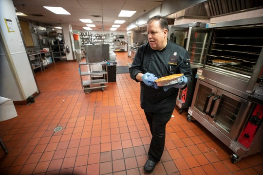 The Brown's executive chef, James Adams, removes Hot Brown pot pies from the oven in the kitchen of the hotel on Tuesday. The slowdown in the economy due to the coronavirus has given Adams time to try out new recipes.