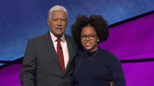East Lansing resident Rachel Burns with Jeopardy! host Alex Trebek on the set of the game show in California in January. She'll compete in an episode set to air Wednesday, March 25 on NBC.