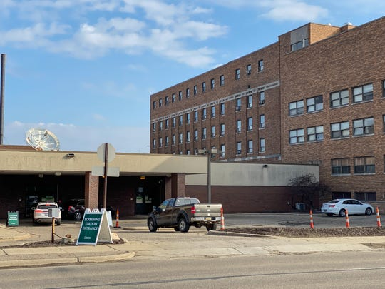 A COVID-19 drive-up screening station test site, seen Tuesday, March 24, 2020, at the Sparrow St. Lawrence campus in Lansing. Sparrow officials stress that this site is only for people who have called ahead and have a doctor or caregiver's order to be tested.