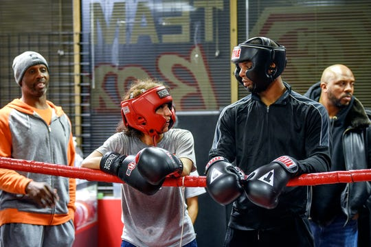 Joseph Hicks Jr., right, and his wife, Zoe, who is a boxer, talk before sparring on Thursday, Feb. 27, 2020, at Team GLASS gym in Lansing. Hicks will represent USA Boxing at middleweight in qualifications for the 2021 Summer Olympics.