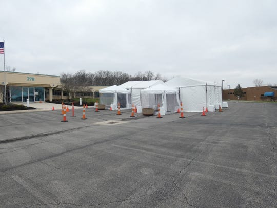 OhioHealth set up tents outside one of its offices at 278 Barks Road, Marion, where the health care system will open a coronavirus testing site Wednesday.