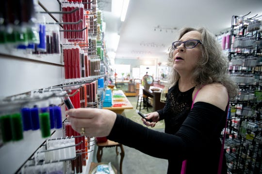 "Della St. Arnold looks for beads Tuesday, March 24, 2020, at The Bead Couture in Memphis. St. Arnold wanted to make sure she got what she needed before the store shut down to comply with the ""Safer at Home"" executive order."