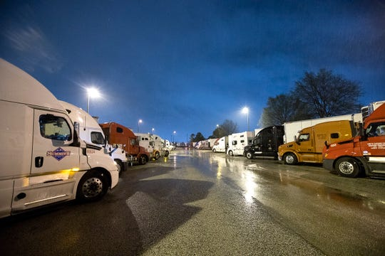 Semi-trucks line up around Kroger supply warehouse on a rain-soaked Tuesday morning where workers are on mandatory overtime, working seven days a week for as much as 16 hour shifts to feed the Mid-South supply chain of grocers as shoppers continue to stock up, cleaning out store shelves around the country.