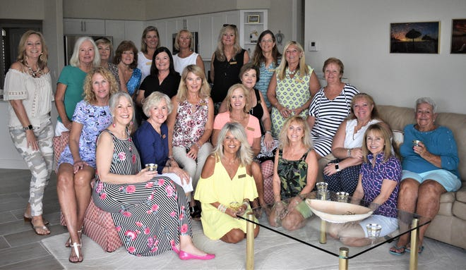 Beach Babes is a group within Newcomers that had luncheon to celebrate the annual change in the chairman for their group.
