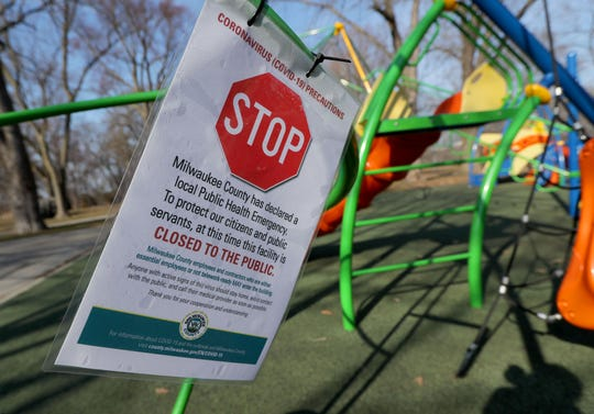 A sign tells people the park is closed at Kern Park on North Humboldt Boulevard in Milwaukee on Tuesday. Wisconsin Gov. Tony Evers' order to close nonessential businesses to slow the spread of the coronavirus pandemic includes playgrounds.